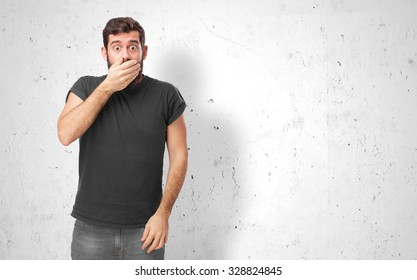 surprised young man covering mouth
