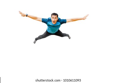 surprised young man flies in widely separated hands isolated on white. Concept fitness or trampoline center