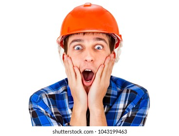 Surprised Young Man in Hard Hat on the White Background closeup