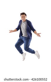 Surprised young man jumping, isolated on white