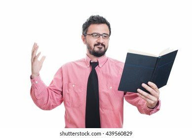 Surprised young man reading a book