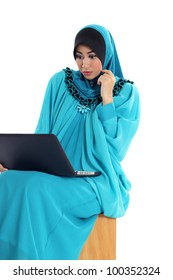 Surprised young muslim woman using laptop isolated on white
