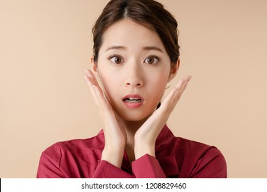Surprised young woman.