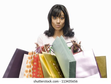 Surprised young woman carrying shopping bags