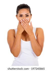 surprised young woman covering her mouth