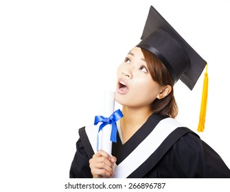 surprised young woman graduating holding diploma and looking