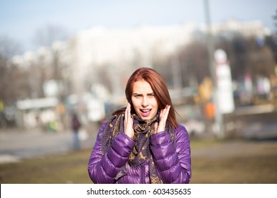 Surprised young woman on street
