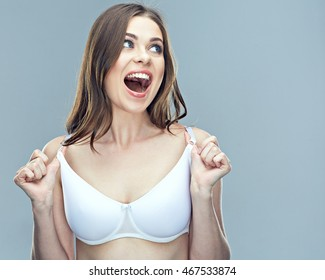 Surprising woman portrait with breast in bra. Health of female breast.