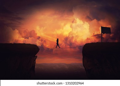 Surreal challenge overcome as woman cross chasm conquering obstacle balancing on slackline rope above the clouds. Way to finish, reach the flag over sunset sky. Achieve goal metaphor, success concept.