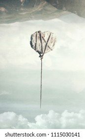 surreal gravity concept, balloon of stone fly in the ground