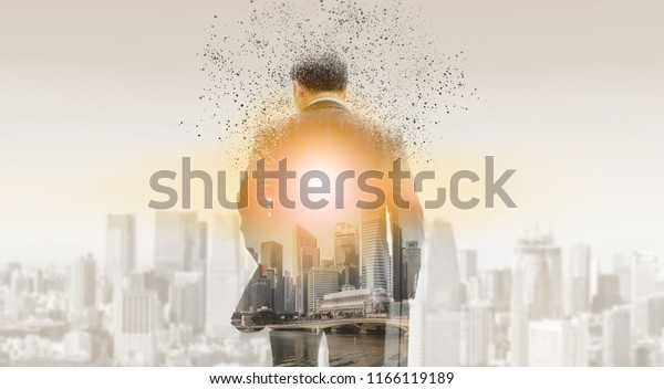 Surreal image of businessman in business suit walking away to modern business buildings and cityscape in the background. Digital innovation and technology disruption concept.