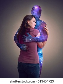 Surreal image of the universe hugging a woman.