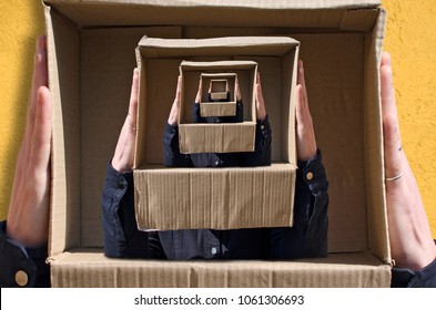 Surreal images with hands holding cardboard box