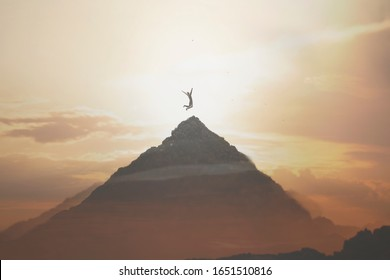 surreal jump of a man on the peak of a mountain, concept of success