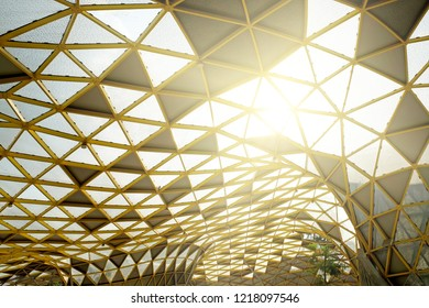 Surreal light ray shining through a roof canopy.