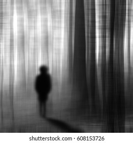 Surreal man walking in the forest at night.