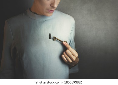surreal moment of a woman who opens the door of her heart with a key
