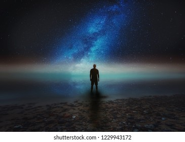 Surreal night landscape with starry sky an man silhouette on shore. Dreamy look.
