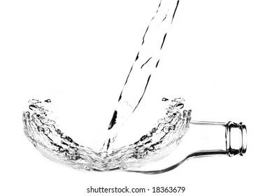 Surreal photo of water splashing on bottle