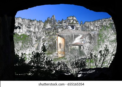 Surreal photography of Home of vultures, Canyon of the Wolves River, Soria, Spain, with church San Bartolomé  from the interior of the prehistoric cave, romanesque,