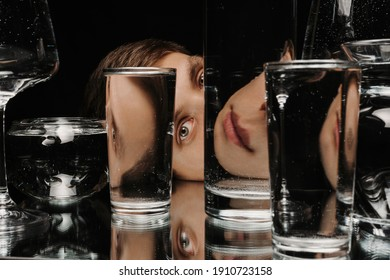 surreal portrait of a man looking through glasses of water with mirror reflections and distortions