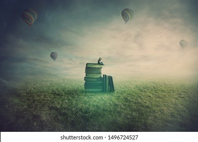 Surreal scene as a minuscule man seated on the top of a books pile in a open foggy field, holding hand to forehead looking at the horizon in search of a new adventure. Non formal education concept.