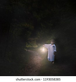 Surreal scene with small boy walking in night with lantern. Horror image.