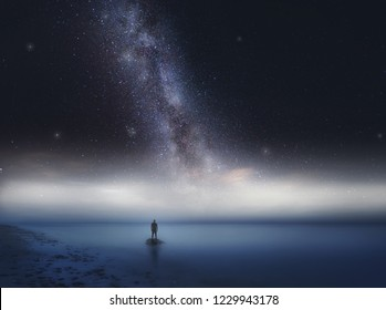 Surreal sea at night landscape with starry sky and man silhouette. Dreamy look.