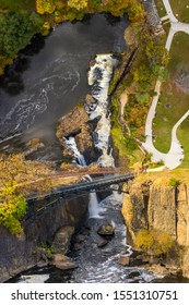 Surreal vertical panorama of Great Falls of the Passaic River in New Jersey, on a sunny afternoon, made using the inception effect or a mind bending distorted perspective.