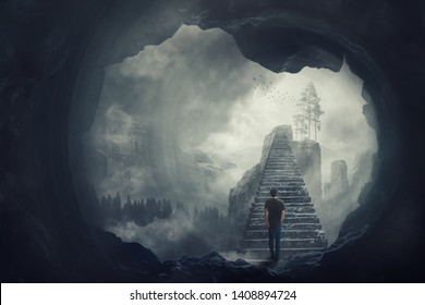 Surreal view as a man escape from a dark cave climbing a mystic stairway crossing the misty abyss going up to unknown paradise. Opportunity staircase, exit way to success, freedom concept.