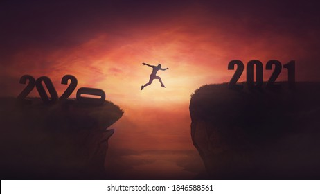 Surreal view, man jumping over a chasm obstacle between old 2020 and new 2021 years. Self overcome, starting a new life. Way to win and success, sunset sky scene. Motivational achieving goals concept.