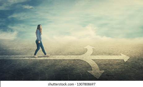 Surreal view as woman walking on a line in front of a crossroad splitted in three different ways as road arrows. Choosing the correct pathway between left, right and front. Difficult decision concept.