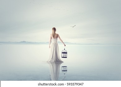 surreal woman release a bird out from a bird cage