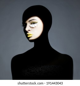 Surrealist portrait of young lady with art makeup