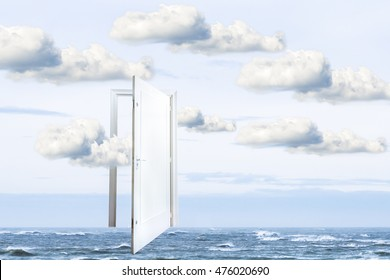 Surrealistic door open on the ocean , door to freedom or to heaven