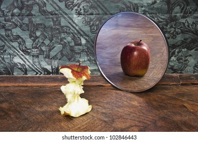 surrealistic picture of an apple reflecting in the mirror