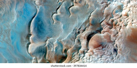 Surrealistic wildlife camouflaging on the sand of the seabed,abstract composition of dune landscape, abstract photography of the deserts of Africa from the air, bird's eye view, abstract expressionism