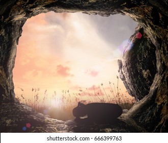 Surrender concept: Silhouette of beautiful woman kneeling and praying on tomb sunset background.