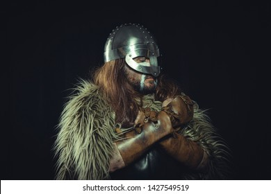 Surrender, Viking, Scandinavian warrior with helmet and war paintings, wears a sword and a cape of animal skin