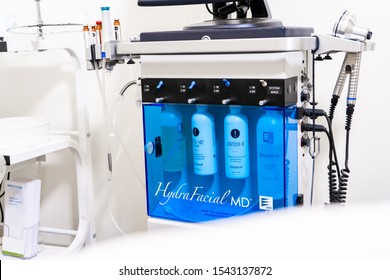Surrey, BC / Canada - 06/11/19: HydraFacial face treatment machine in a beauty spa clinic for an exfoliation anti-aging or acne treatment. Shows bottles for skin cleansing and infusion.