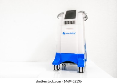 Surrey, BC / Canada - 06/11/19: Miniature Coolsculpting machine model in a medspa clinic, on a white background. Used for cryolipolysis treatment to remove fat.