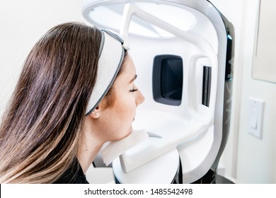 Surrey, BC / Canada - 07/16/19: woman having a uv skin scan to create an imaging model of sun damage, using the VISIA facial scanner.