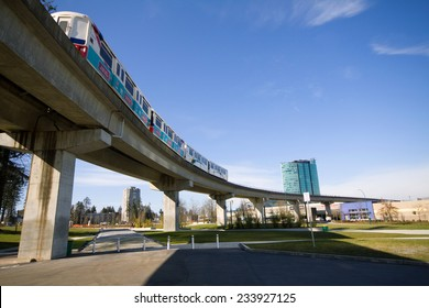 SURREY, BC, CANADA - MARCH 2009: Skytrain passes overhead, Holland Park, Surrey Central, BC, Canada. Skytrain is a fully automated rapid transit system built by Bombardier.