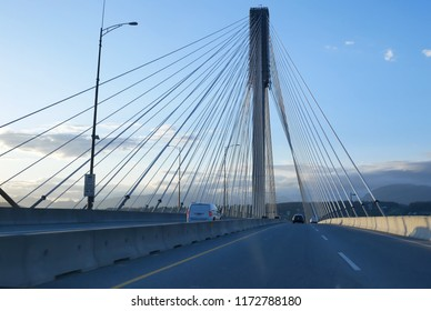 Surrey, BC, Canada - May 31, 2018 : POV view of riding over the bridge in Surrey BC Canada
