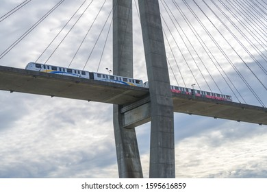 Surrey, British Columbia / Canada - June 2, 2019: A skytrain passing over the TransLink SkyBridge between New Westminster and Surrey.