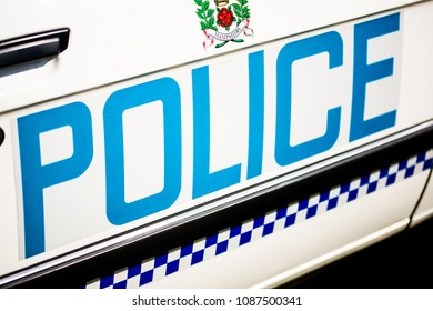 Surrey, UK. 7th May 2018. EDITORIAL - Elevated view of large police sign on the side of a patrol car.
