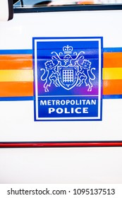 Surrey, United kingdom. 7th May 2018. EDITORIAL - Large blue Metropolitan Police sign with coat of arms, on the side of a police patrol vehicle in Surrey, UK.
