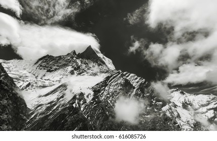 """Surrounded by clouds"" - a series of color and black and white photographs, dedicated to one of the most beautiful peaks of the Himalayas - Machapuchare."