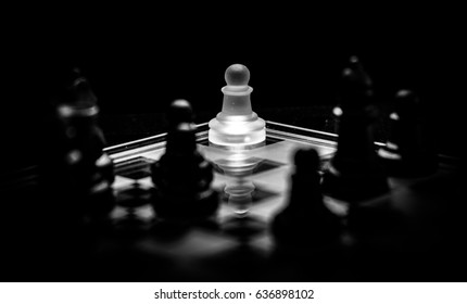"""""""Surrounded"""" A white piece pawn is cornered by many black pieces. The pawn will eventually become Queen and may turn the tide."""