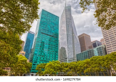 Surrounding buildings and skyscrapers visible from the Bryant Park during the gloomy weather in Manhattan, New York